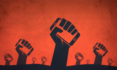 An illustration of fists holding up phones.